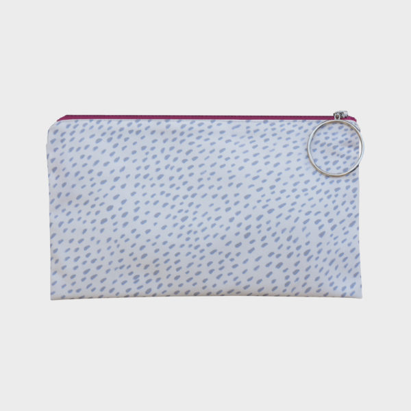 Confetti clutch on geometric and abstract patterns is printed on polyester and has colourful zipper by m.k.e textiles