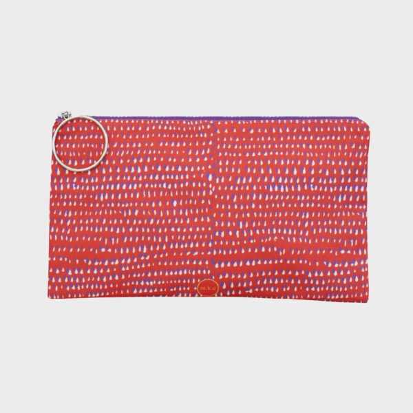 Paintball clutch on dotty patterns is printed on polyester and has colourful zipper by m.k.e textiles