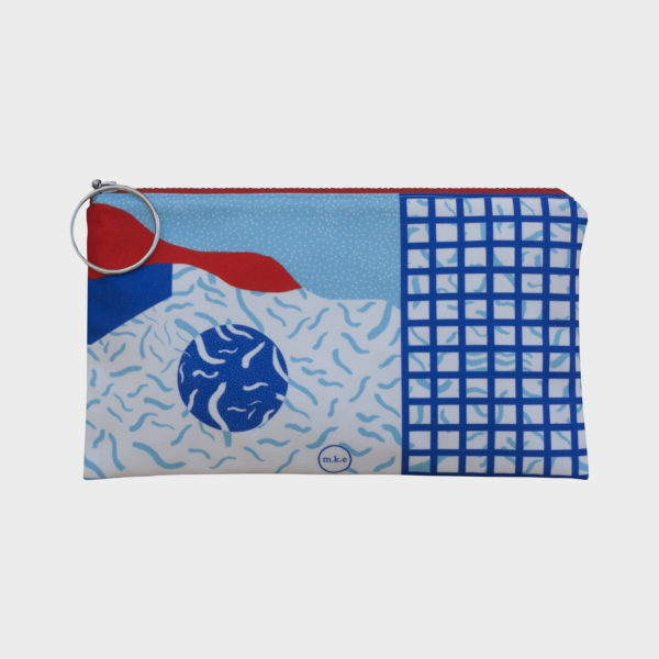 Pool party clutch on blue shades and orange details is printed on polyester and has colourful zipper by m.k.e textiles