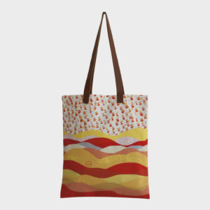 Sunset tote bag on orange and yellow shades is printed on polyester and has leather handles by m.k.e textiles